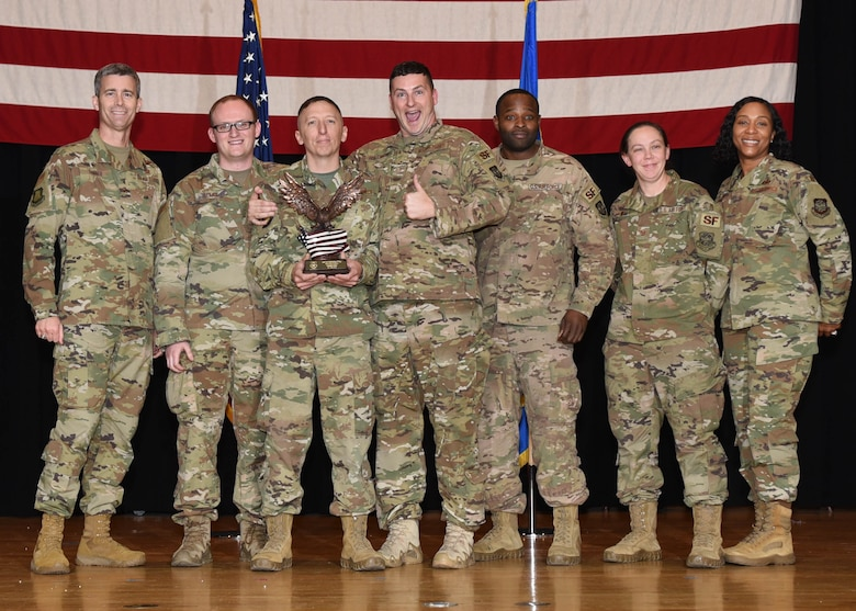 The 22nd Combat Arms section, 22nd Security Forces Squadron, receives an award Nov. 8, 2019, At McConnell Air Force Base, Kan. The 22nd Combat Arms section was one of five teams to go up for the 22nd Air Refueling Wing's Team of the 3rd Quarter Award. (U.S. Air Force photo by Airman 1st Class Alexi Bosarge)