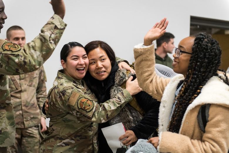 Airman 1st Class Kuyeon Bates (right), 2nd Force Support Squadron unit deployment manager, embraces Senior Airman Mia Luciano (left), 2nd FSS UDM, after returning from a short-term deployment to RAF Fairford, England, Nov. 14, 2019, at Barksdale Air Force Base, La. Over 300 Airmen and four B-52H Stratofortress aircraft were deployed in support of U.S. Strategic Command's Bomber Task Force. (U.S. Air Force photo by Airman 1st Class Lillian Miller)