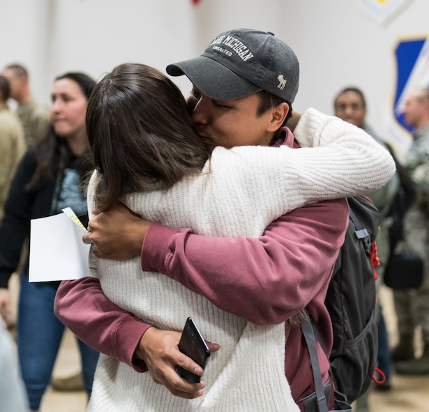 An Airman assigned to the 2nd Bomb Wing reunites with a loved one after returning from a short-term deployment to RAF Fairford, England, Nov. 14, 2019, at Barksdale Air Force Base, La. Over 300 Airmen and four B-52H Stratofortress aircraft were deployed in support of U.S. Strategic Command's Bomber Task Force. (U.S. Air Force photo by Airman 1st Class Lillian Miller)