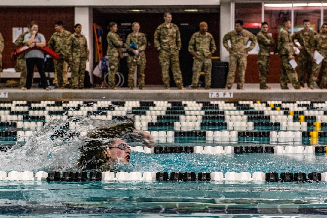 A German Armed Forces Proficiency Badge (GAFPB) competitor races to the finish line during the 100-meter swim in Columbia, South Carolina (S.C.), Nov. 8, 2019.