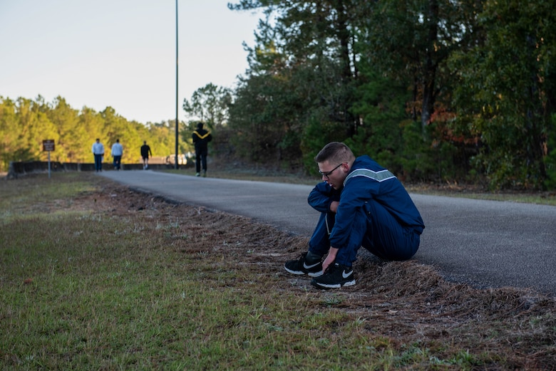 A U.S. Airman sits on the edge of the track after a 1000-meter sprint at the McCrady Training Center in Eastover, South Carolina, Nov. 9, 2019.