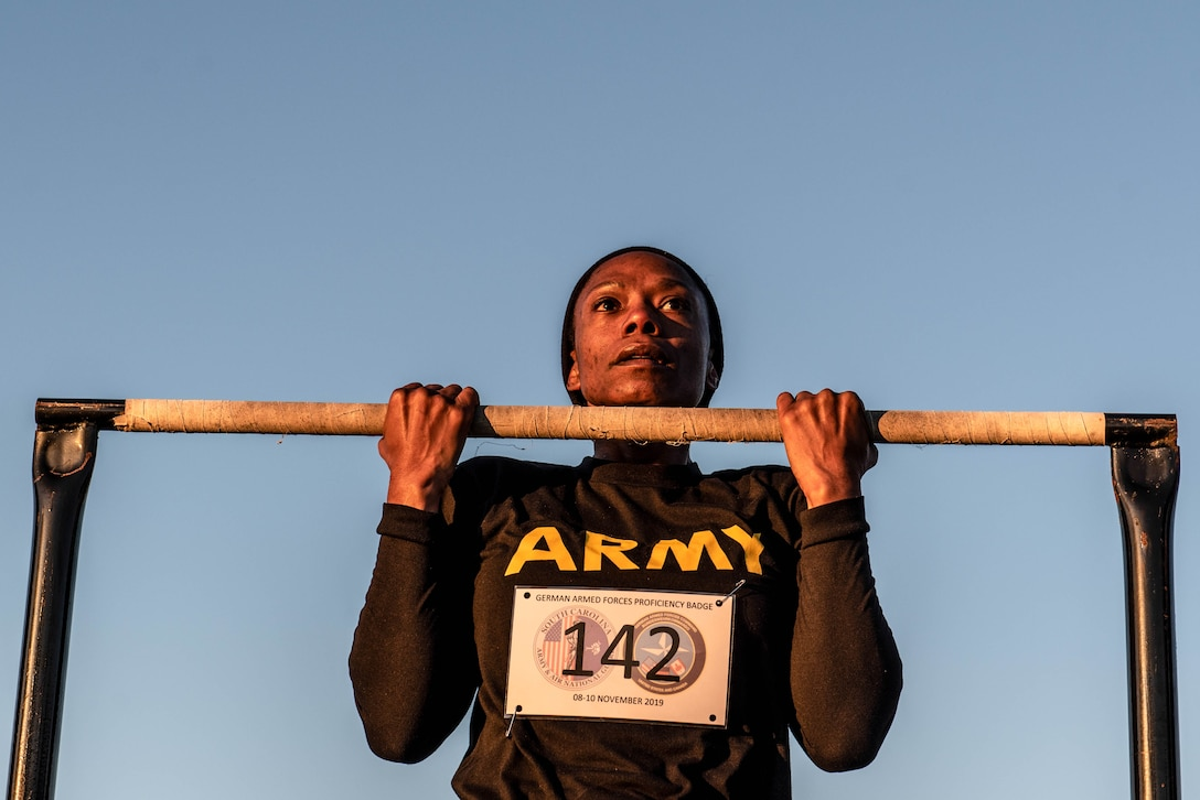 A U.S. Soldier grips a pull-up bar during the flexed arm hang portion of a German Armed Forces Proficiency Badge competition at McCrady Training Center in Eastover, South Carolina, Nov. 9, 2019.