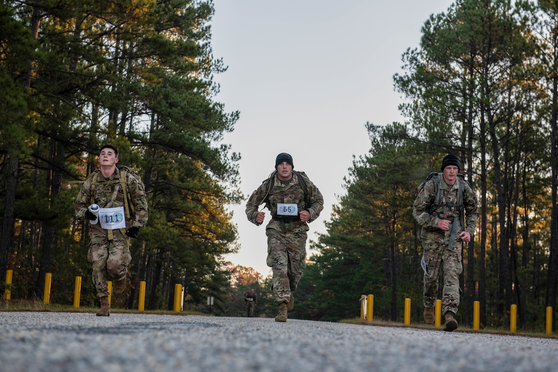 German Armed Forces Proficiency Badge competitors sprint during the ruck portion of the test at McCrady Training Center in Eastover, South Carolina, Nov. 10, 2019.