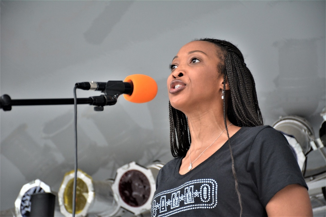 Special guest Patricia Conyers, a member of the Center for American Military Music Opportunities group, sings the National Anthem at Fort Lee's Inaugural 2019 Suicide Awareness 5k Sept. 14, 2019. The event was hosted by the 2nd Brigade Headquarters and Headquarters Company, 94th Training Division-Force Sustainment and designed to raise suicide awareness amongst our nation's service members.
