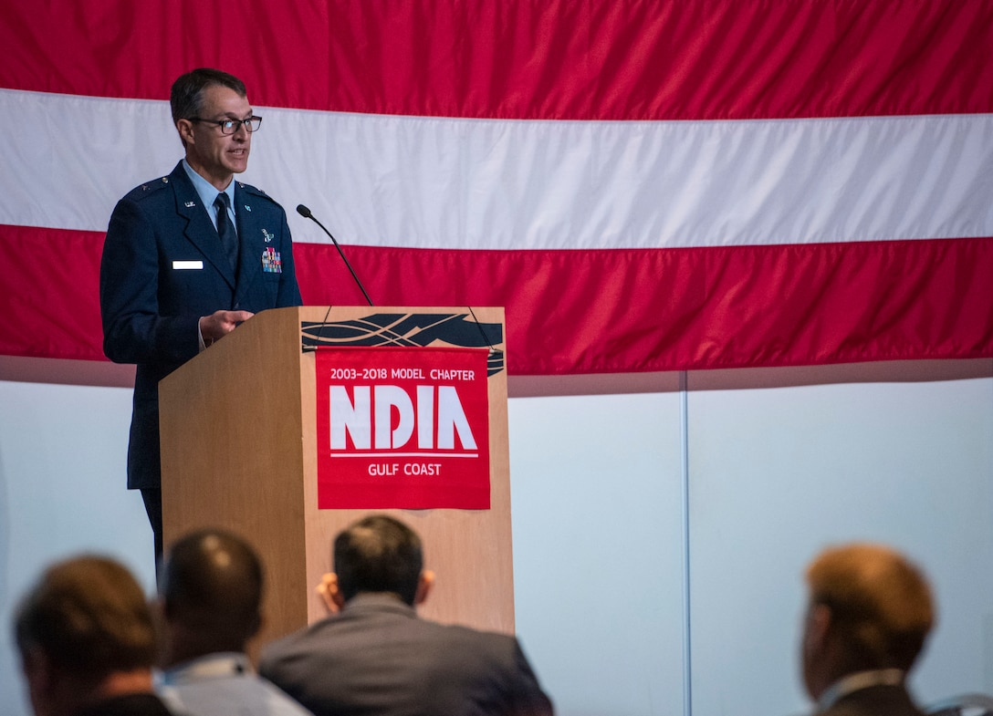 Brig. Gen. Scott Cain, 96th Test Wing commander, speaks at The National Defense Industrial Association's Gulf Coast Chapter's 45th Armament Symposium Nov. 6 in Fort Walton Beach, Fla.