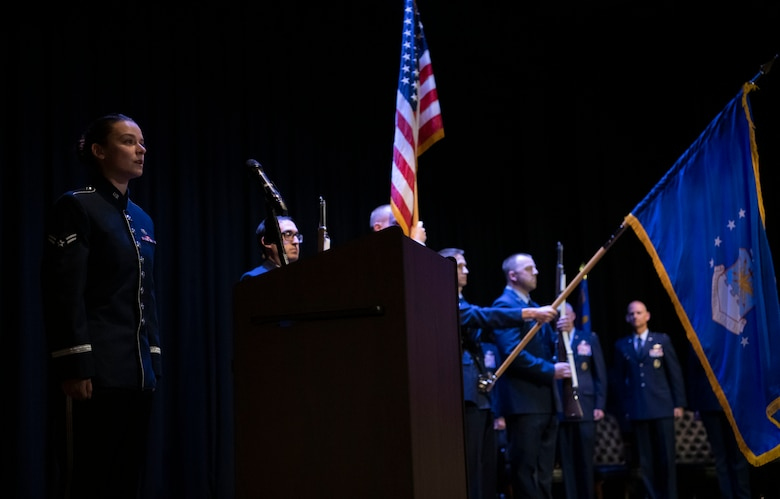 A1C Dana Bowers, Band of Mid America, Sings the anthem with CCC color guard in the background.