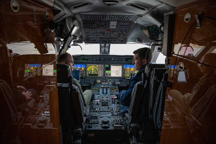 Pilots and flight attendants visit the 97th AMW.