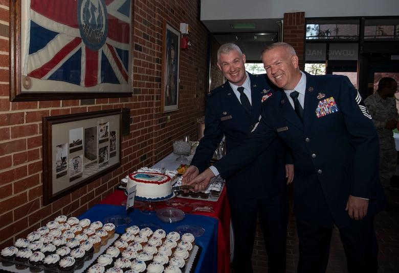 CC and CEM cut cake following Re-designation Ceremony 7 Nov 2019