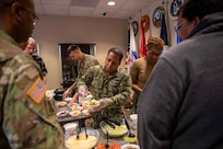 U.S. Navy Information Systems Technician First Class Albert Givens, president of Joint Task Force Civil Support's Morale, Welfare and Recreation committee, serves nachos during a MWR event at the command. The nacho sale was one of many events held throughout the year to promote positive morale and well-being of personnel at the command. (Official DoD photo by Mass Communication Specialist 3rd Class Michael Redd/RELEASED)
