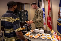 U.S. Marine Corps Staff Sargent Jordan Freking, a member of Joint Task Force Civil Support's Morale, Welfare and Recreation committee, serves nachos during a MWR event at the command. The nacho sale was one of many held throughout the year to promote positive morale and well-being of personnel at the command. (Official DoD photo by Mass Communication Specialist 3rd Class Michael Redd/RELEASED)