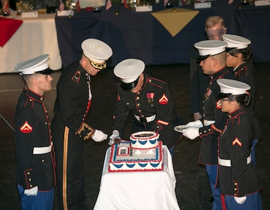 Col. Craig C. Clemans, commanding office of marine Corps Logistics Base Barstow, assisted by Tim Hille, commander of the High Desert Marines performs the traditional cake-cutting ceremony during MCLB Barstow/High Desert Marines 244th Birthday Ball Nov. 2.