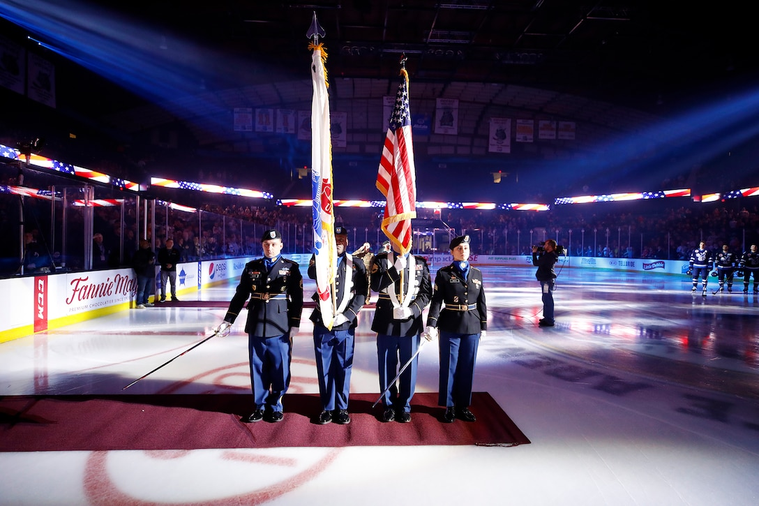 The 85th U.S. Army Reserve Support Command Color Guard team presents the Nation's Colors before the start of a Chicago Wolves hockey game at the Allstate Arena in Rosemont, Illinois, November 9, 2019.