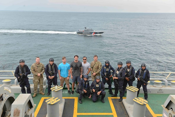 US Coast Guard Maritime Enforcement Specialists and Malaysian Maritime Enforcement Agency coast guardsmen pose for a group photo after conducting a visit, board, search-and-seizure training drill as part of Southeast Asia Cooperation and Training (SEACAT) 2019. This year marks the 18th iteration of SEACAT, which is designed to enhance maritime security skills by highlighting the value of information sharing and multilateral coordination. (US Navy photo by Mass Communication Specialist 2nd Class Tristin Barth)