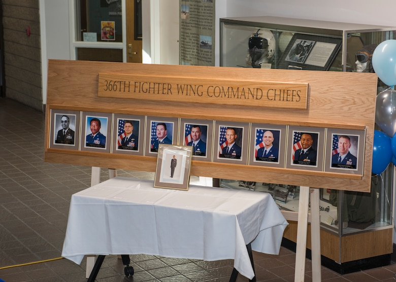 A wooden fixture holds the pictures of past 366th Fighter Wing command chief as a part of Chief Legacy Program ceremony, Nov. 11, 2019, at Mountain Home Air Force Base, Idaho. The fixture is part of a legacy wall within the 366th Fighter Wing used to document and honor prior command chiefs. (U.S. Air Force photo by Senior Airman Tyrell Hall)