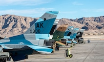 U.S. Air Force F-16 Fighting Falcons from 18th Aggressor Squadron are lined up on the flight line at Nellis Air Force Base, Nevada, Nov. 6, 2019. Eielson AFB sent a mobile training team, consisting of eight F-16s, to Nellis in support of the U.S. Air Force Weapons Instructor Course. (U.S. Air Force photo by Nellis Air Force Base Public Affairs)