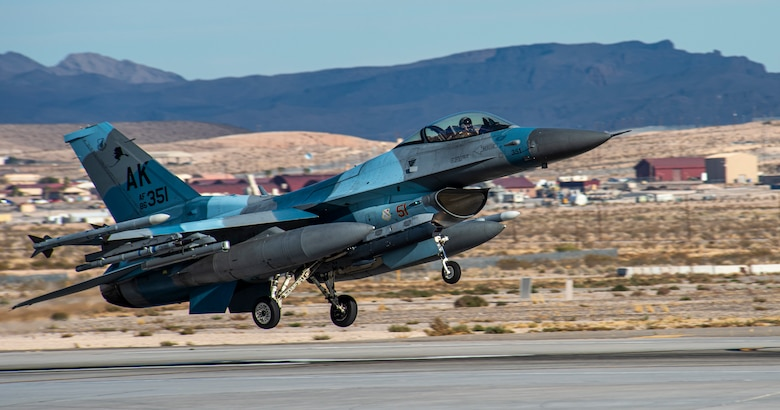 A U.S. Air Force F-16 Fighting Falcon from the 18th Aggressor Squadron takes off at Nellis Air Force Base, Nevada, Nov. 6, 2019. The 18th AGRS utilizes a mobile training team that gives them opportunities to travel to another base and prepare Combat Air Force, joint and allied aircrews on how to fight and overcome a realistic adversary. (U.S. Air Force photo by Nellis Air Force Base Public Affairs)