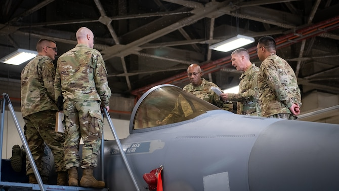 U.S. Air Force Gen. CQ Brown, Jr., Pacific Air Forces commander, inspects an F-15C Eagle during a tour at Kadena Air Base, Japan, Nov. 12, 2019. During the tour, Brown visited various base squadrons and agencies to learn about unit-specific issues, their operations, and answer questions. (U.S. Air Force photo by Staff Sgt. Benjamin Raughton)