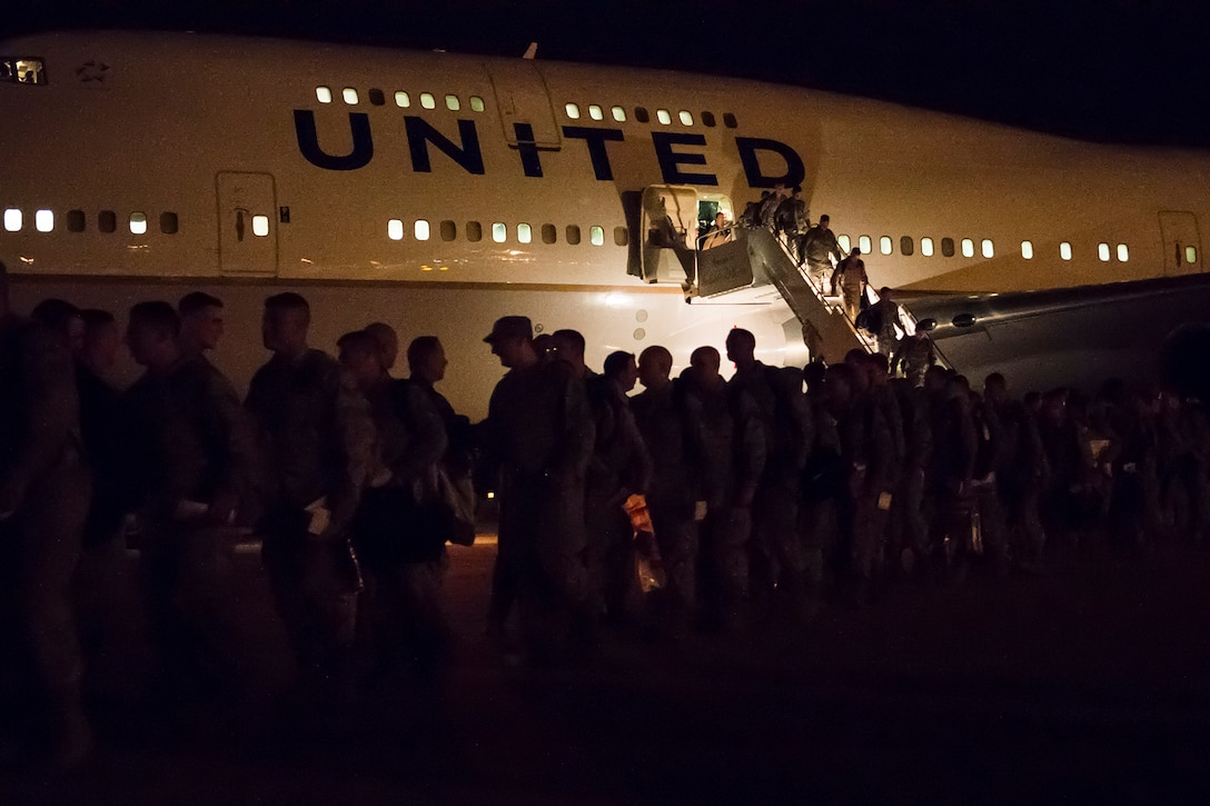 Photo of Airmen returning home from deployment