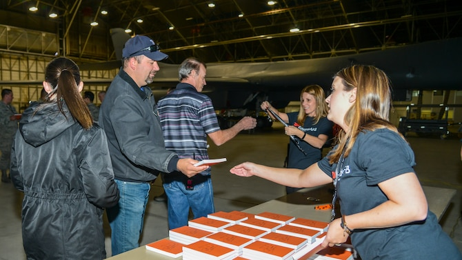 SparkED Team Member Britney Reed and Cherie Head, SparkED Team Lead, hand out Eddie's Challenge 19.2 materials during a, innovation challenge kick-off event at Edwards Air Force Base, Nov. 8. (Air Force photo by Giancarlo Casem)