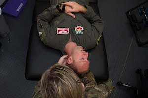 U.S. Air Force Capt. Michelle Jilek, 633rd Medical Operations Squadron physical therapist, examines Maj. Seth Rumbarger, 71st Fighter Squadron T-38 Talon pilot, at Joint Base Langley Eustis, Virginia, Nov. 13, 2019.