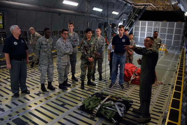 Senior Airman Thomas G. Wawrzyniak, 68th Airlift Squadron loadmaster, talks about the C-5M Super Galaxy's cargo compartment with Civil Air Patrol cadets Nov. 6, 2019 at Joint Base San Antonio-Lackland, Texas (U.S. Air Force photo by Staff Sgt. Lauren M. Snyder)