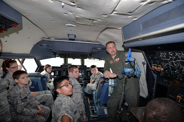 Lt. Col. Cliff Jackson, 68th Airlift Squadron pilot, describes the C-5M Super Galaxy flight engineer station to Civil Air Patrol cadets Nov. 6, 2019 at Joint Base San Antonio-Lackland, Texas (U.S. Air Force photo by Master Sgt. Kristian Carter)