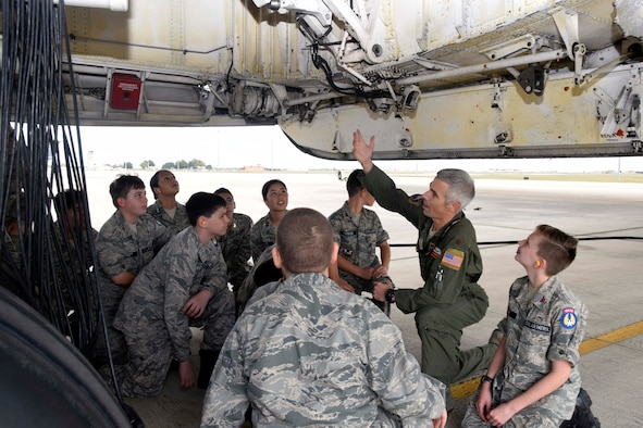 Maj. Matt Menendez, 68th Airlift Squadron pilot, talks to Civil Air Patrol cadets about the C-5M Super Galaxy landing gear to Civil Air Patrol cadets Nov. 6, 2019 at Joint Base San Antonio-Lackland, Texas (U.S. Air Force photo by Staff Sgt. Lauren M. Snyder)