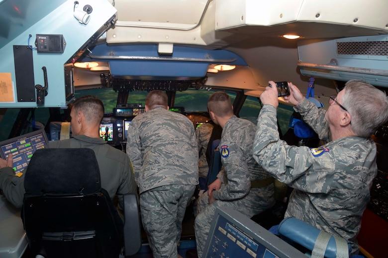 Senior Master Sgt. Brian Mizula, 733rd Training Squadron instructor flight engineer, shows the a C-5M Super Galaxy flight deck simulator to Civil Air Patrol cadets Nov. 6, 2019 at Joint Base San Antonio-Lackland, Texas (U.S. Air Force photo by Staff Sgt. Lauren M. Snyder)
