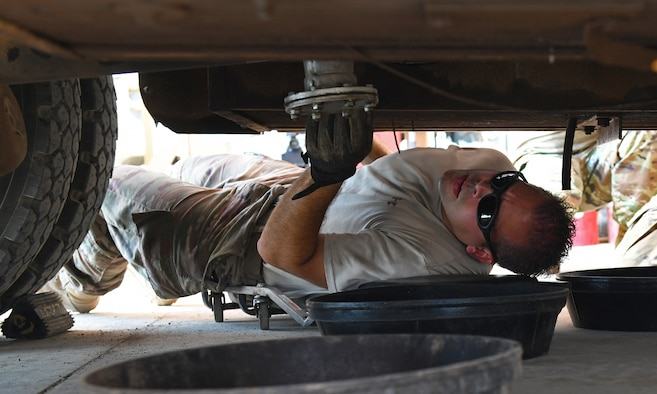 U.S. Air Force Tech. Sgt. James Hopper, 726th Expeditionary Air Base Squadron Vehicle Maintenance flight chief investigates a leak on a C300 refueling truck at Chabelley Airfield, Djibouti, Nov. 8, 2019. Hopper is deployed to Camp Lemonnier, Djibouti, from the 7th Logistics Readiness Squadron at Dyess Air Force Base, Texas. (U.S. Air Force photo by Staff Sgt. Alex Fox Echols III)