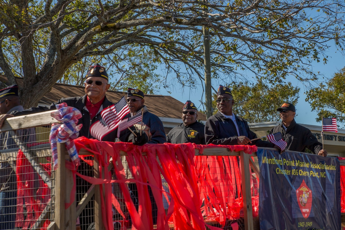 Montford Point Marine veterans participate in the 2019 annual Carteret County Veterans Day Parade in Morehead City, North Carolina, Nov. 9, 2019. The annual observance of Veterans Day gives Americans the opportunity to honor the brave men and women who made the sacrifice to serve their country. Participants of the parade included local politicians, the 2nd Marine Aircraft Wing marching band, the Naval Health Clinic Cherry Point color guard, and local veteran organizations.