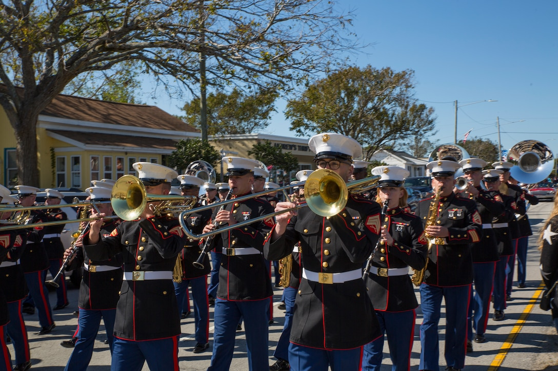 Marines with the 2nd Marine Aircraft Wing marching band fill the streets during the 2019 annual Carteret County Veterans Day Parade in Morehead City, North Carolina, Nov. 9, 2019. The Carteret County Veterans Day Parade has grown from only a handful of participants to over 2,000 participants honoring our veterans and is now the largest Veterans Day Parade in North Carolina. The parade was established to allow veterans, veterans' service organizations, individuals, and any other group/organization the opportunity to remember and to honor our nation's veterans who have proudly served this country.