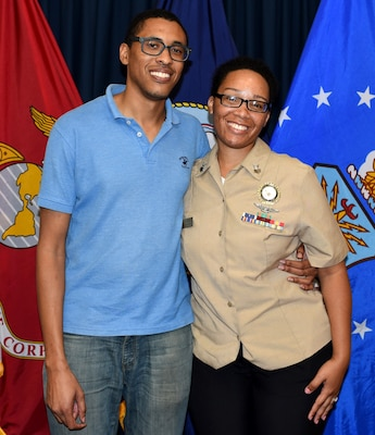 Christopher Delaney of Houston joined America's Navy during an enlistment ceremony held at the San Antonio Military Entrance Processing Station Oct. 23.  Delaney, who will served in the aviation ordnance career field, is married to Petty Officer 1st Class Kamitria Delaney (right), assigned to Navy Recruiting District San Antonio.