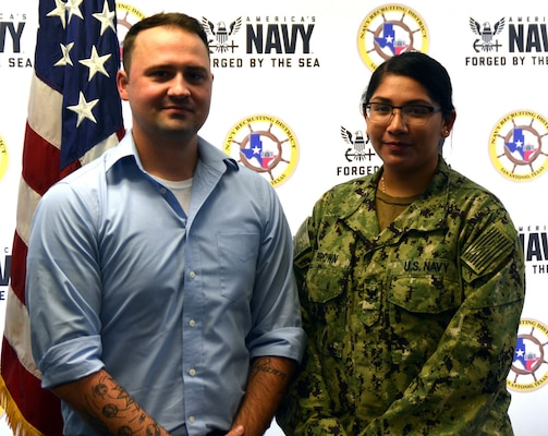 Petty Officer 3rd Class Christian Brown (left) rejoined America's Navy as a Reservist during an enlistment ceremony held at Navy Recruiting District San Antonio headquarters Oct. 16.  Brown first entered the Navy in 2013 serving four years and will be assigned to Navy Operations Support Center San Antonio. He is joined by his wife, Petty Officer 2nd Class Angelica Brown, the NRD San Antonio community relations coordinator.