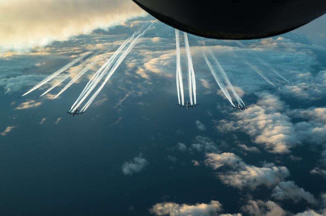Three U.S. Air Force B-52H Stratofortress aircraft, assigned to the 2nd Bomb Wing from Barksdale Air Force Base, Louisiana, and five Royal Norwegian Air Force F-16 Fighting Falcons fly together toward the Barents Sea region of the Arctic during Bomber Task Force 20-1, Nov. 6, 2019. This deployment allows aircrews and support personnel to conduct theater integration and improve bomber interoperability with joint partners and allied nations. (U.S. Air Force photo by Staff Sgt. Trevor T. McBride)