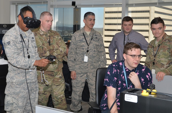 Chief Master Sgt. Peter Franco, 55th Communication Group, superintendent and members of the 55th CG test virtual reality features April 19, 2019 at Booz Allen Hamilton in Omaha, Nebraska. was born into a band of mission Native Americans, serves in the highest enlisted Air Force rank of chief master sergeant here. He leads cyber professionals in protecting base communications and computer systems.