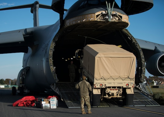 A C-5M Super Galaxy is unloaded during Total Force/Joint Training Exercise Diamond Wing at New Castle Air National Guard Base, Del., Nov. 14, 2019. The C-5M Super Galaxy is the largest strategic airlifter in the Department of Defense and is capable of carrying over more than 280-thousand pounds of cargo. (U.S. Air National Guard Photo by Staff Sgt. Katherine Miller)