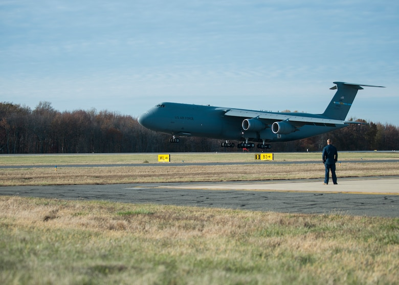 A C-5M Super Galaxy lands on the runway during Total Force/Joint Training Exercise Diamond Wing at New Castle Air National Guard Base, Del., Nov. 14, 2019. During the exercise, cargo, vehicles and personnel from the DNG's 31st Civil Support Team were loaded and transported in addition to other DNG Army and Air Guard vehicles and personnel. (U.S. Air National Guard Photo by Staff Sgt. Katherine Miller)