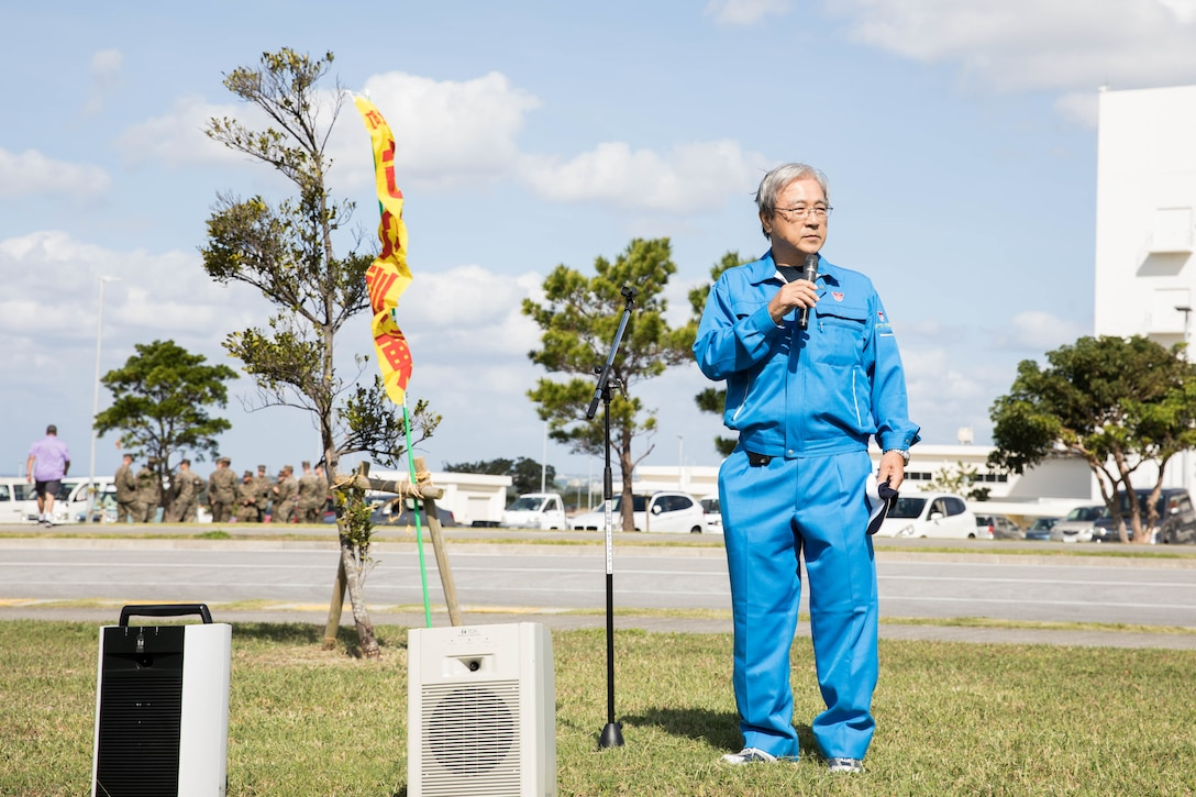 Masakatsu Kamiyama, vice mayor of Chatan Town, speaks to during a closing ceremony as part of a Tsunami Evacuation Drill, Camp Foster, Okinawa, Japan, Nov. 9, 2019. The drill was held to convey the readiness and capabilities of the camp to members of the U.S. and local communities in the event of an emergency.