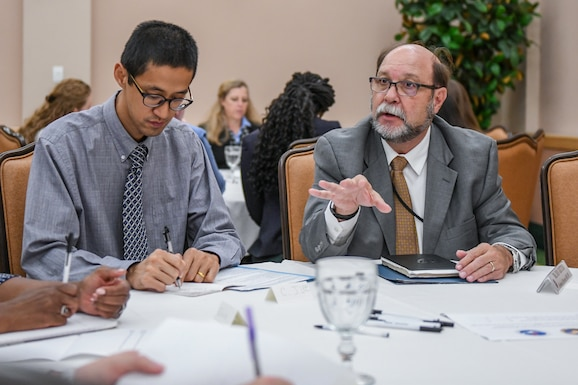 Mr. John Kretzer (right), 688 Cyberspace Wing, technical director, speaks with Joint Base San Antonio (JBSA) mentees during a mentor session at JBSA-Lackland, TX, Gateway Club Aug. 22, 2019. JBSA-Lackland hosted a mentor session between Senior Air Force Civilians and JBSA civilian mentees. Mentors included; Anthony Reardon, the Administrative Assistant to the Secretary of the Air Force; Gwendolyn DeFilippi, the Principal Assistant to the Deputy Chief of Staff for Manpower, Personnel and Services; Carlos Bassut, 502D Air Base Wing & JBSA, technical director; Michael Bensen, Airman & Family Services Enterprise Management, Installation Support Directorate, division chief; John Kretzer, 688 Cyberspace Wing, technical director. While here, they communicated and interacted with the civilian workforce regarding career and developmental opportunities, paths to senior civilian positions and answered questions in a non-attribution environment. (U.S. Air Force Photo by Andrew C. Patterson)