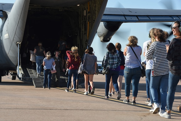 Spouses of Airmen board a C-130J Super Hercules,at Dyess Air Force Base, Texas, Oct. 5, 2019. The 317th Airlift Wing organized a Spouse Day to show appreciation to spouses for their support and sacrifices. (U.S. Air Force photo by Airman 1st Class Colin Hollowell)