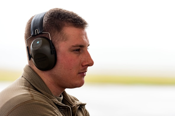 A photo of an Airman waiting for the departure of an aircraft.