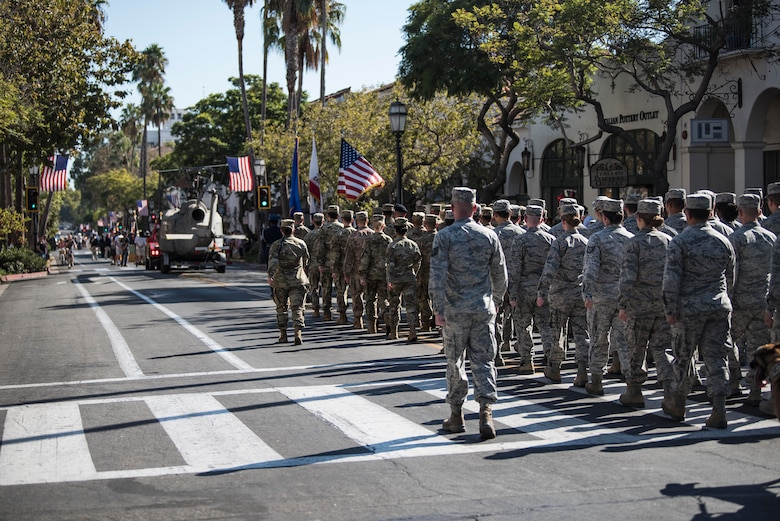 Service members from Vandenberg Air Force Base march during the Santa Barbara Veterans Day Parade Nov. 9, 2019, in Santa Barbara, Calif. During the parade, Vandenberg displayed two flights of Airmen, as well as Military Working Dogs, Military Working Horses, an honor guard team and a variety of military vehicles. (U.S. Air Force photo by Airman 1st Class Hanah Abercrombie)
