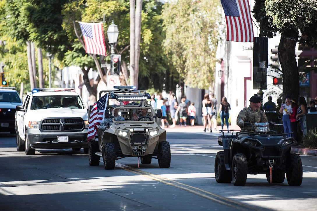 Service members from Vandenberg Air Force Base drive a variety of military vehicles during the Santa Barbara Veterans Day Parade Nov. 9, 2019, in Santa Barbara, Calif. Approximately 116 Airmen from Vandenberg marched in the parade as well as four military working horses, two military working dogs and ten vehicles. (U.S. Air Force photo by Airman 1st Class Hanah Abercrombie)
