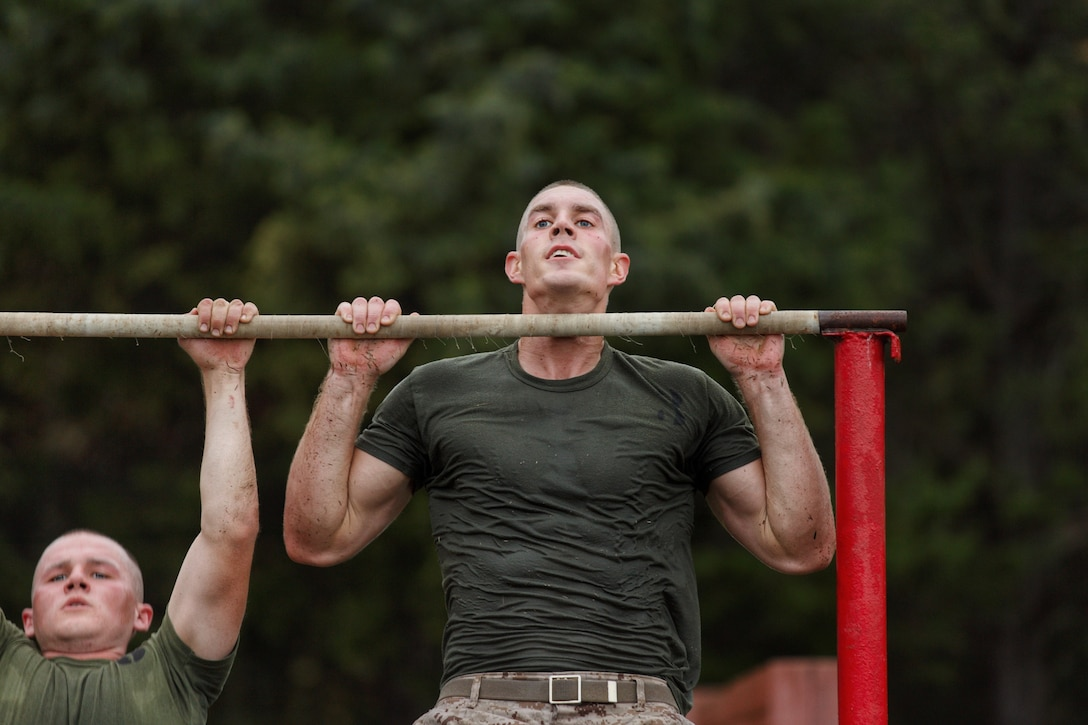 Noah Furbush, 24, a Marine Corps Officer Candidate, conducts pull-ups physical training at Marine Corps Officer Candidates School in Quantico, Virginia, November 5, 2019. The exercise challenges candidates' ability to navigate on land, give orders and execute the mission effectively. The mission of Officer Candidates School is to educate and train officer candidates in Marine Corps knowledge and skills within a controlled and challenging environment in order to evaluate and screen individuals for the leadership, moral and physical qualities required for commissioning as a Marine Officer.