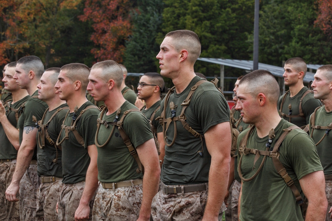 Noah Furbush, 24, a Marine Corps Officer Candidate, participates in physical training at Marine Corps Officer Candidates School in Quantico, Virginia, October 31, 2019. The exercise challenges candidates' ability to navigate on land, give orders and execute the mission effectively. The mission of Officer Candidates School is to educate and train officer candidates in Marine Corps knowledge and skills within a controlled and challenging environment in order to evaluate and screen individuals for the leadership, moral and physical qualities required for commissioning as a Marine Officer.