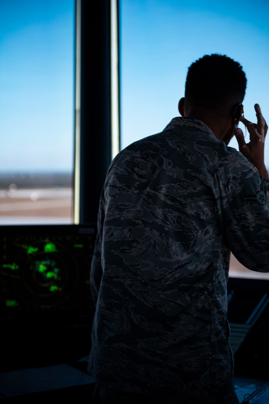 Airman 1st Class Treyzhaun, 325th Operations Support Squadron, air traffic controller, communicates with inbound and outbound pilots trafficking the runway in support of exercise Checkered Flag 20-1 at Tyndall Air Force Base, Florida, Nov. 13, 2019. Checkered Flag is a large-scale exercise involving multiple military partners and installations, designed to focus on training and evaluating fourth and fifth-generation fighter aircraft, pilots and maintainers. In conduction with the exercise, air-to-air and air-to-ground combat operations are tested and recorded to provide data on best practices and ensuring future mission successes. (U.S. Air Force photo by Staff Sgt. Magen M. Reeves)