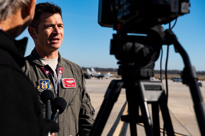 Lt. Col. Benjamin Orsua, Checkered Flag 20-1 exercise director, is interviewed by local media stations at Tyndall Air Force Base, Florida, Nov. 13, 2019. Checkered Flag is a large-scale exercise involving multiple military partners and installations, designed to focus on training and evaluating fourth and fifth-generation fighter aircraft, pilots and maintainers. In conduction with the exercise, air-to-air and air-to-ground combat operations are tested and recorded to provide data on best practices and ensuring future mission successes. (U.S. Air Force photo by Staff Sgt. Magen M. Reeves)