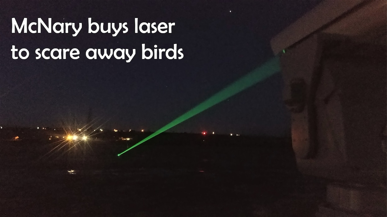 photo of green laser shining into the night