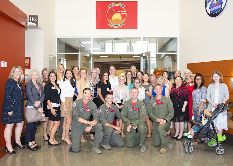 Dawn Goldfein, wife of Air Force Chief of Staff Gen. David L. Goldfein, poses with Luke Air Force Base key spouses and 56th Training Squadron instructor pilots Nov. 8, 2019, at Luke Air Force Base, Ariz.