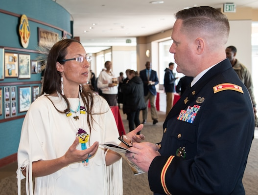 Dr. Yvette Running Horse Collin, co-founder of Sacred Way Sanctuary and the keynote speaker during the National American Indian Heritage Month observance at Redstone Arsenal, Alabama, Nov. 13, 2019, talks with Lt. Col. H. W. Hugh Darville, deputy commander of the U.S. Army Engineering and Support Center, Huntsville, after the event. The observance was organized by Huntsville Center's Equal Employment Opportunity office in coordination with Team Redstone and the U.S. Army Aviation and Missile Command. Sacred Way Sanctuary is an education and research facility in Florence, Alabama, dedicated to preserving the Native American horse and other animals sacred to indigenous peoples of the Americas.